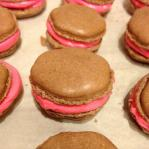 They look like little burgers, but they are red velvet macarons with cream cheese filling