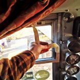 awesome velcro screens for our bus window made by talented PDX artist/designer, Melissa DeMerit!